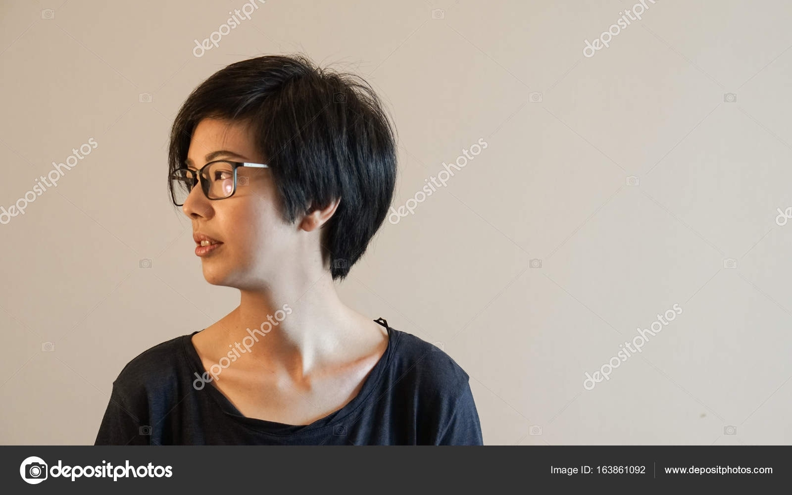 Asian Woman With Short Hair And Glasses On Color Background — Stock with regard to Amazing Asian Hairstyle With Glasses