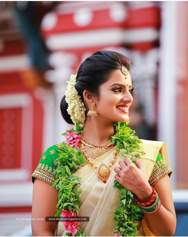 Kerala Kasavu Saree. South Indian Bride. Traditional Indian for Indian Wedding Hairstyles For Sarees